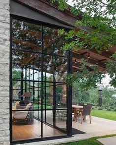 Lindo como a janelona integra com parede de pedras e a natureza Boa semana! (Via Veredas Arquitetura) & jean de merry | Black trim Kara and Window