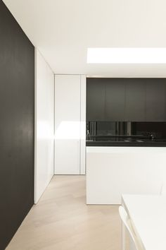 Black and white kitchen. House K in Belgium by Graux & Baeyens Architecten _