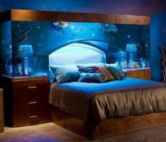 Fish tank headbord. Pretty cool, but I wouldn't want to clean this tank!