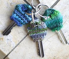 Free Knitting Pattern for Key Cozies - These tiny key sweaters are great for identifying your keys, keeping them warm in winter, using up stash yarn and learning Magic Loop techniques. Designed by Liat Gat who has included an instructional video.