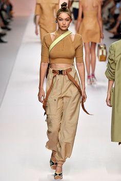 If you thought cargo pants belonged to your twerpy little brother in the Gigi Hadid in Fendi might change your mind. See that outfit plus more of our favorite looks from Milan Fashion Week here. Fashion Walk, Trend Fashion, Milan Fashion Weeks, Runway Fashion, Spring Fashion, High Fashion, Womens Fashion, Fashion Design, Fashion Styles