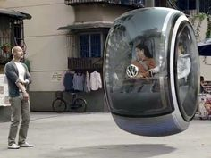 Got get me one of these. The Volkswagen Hover Concept Car is a pod-like zero-emissions vehicle that uses electromagnetic road networks to float above the road.