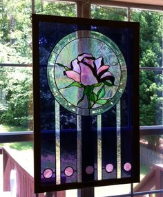 Large stained glass window hanging.