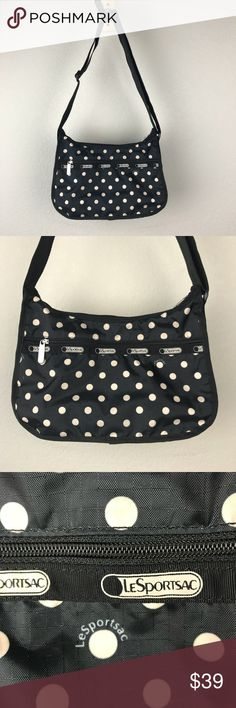 LeSportsac Black Vinyl Polka Dot Crossbody Purse LeSportsac Black and white vinyl polka dotted zippered purse that can be worn shoulder or crossbody. Excellent used condition, no holes tears or stains. Polka dots are big for spring, so get like Minnie Mouse and grab this purse for your next Disney trip. Also completed rockabilly and pinup looks well. LeSportsac make my favorite concert purses since they are easy to clean. Lesportsac Bags Crossbody Bags