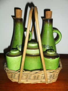 A Set of Ceramic Bottles & Shakers in a Basket.  (SOLD)