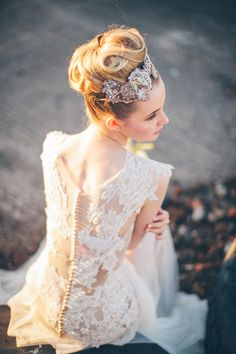 stunning wedding dress with lace back detail. Read More - http://onefabday.com/elegant-industrial-wedding-photography/