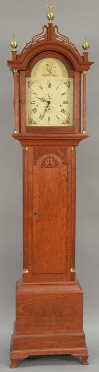 R. H. Effinger cherry tall case clock having shell carved door flanked by brass stop fluted quarter columns, all set on ogee feet, brass works with chimes and painted porcelain dial marked R.H. Effinger, Fryburg, ME, 20th [...more]  Estimate: $800 - $1200