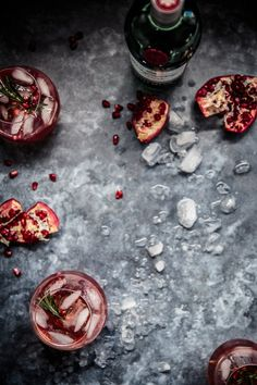 Fresh pomegranate juice mixed with gin, lemon juice, rosemary sugar syrup and topped with soda water. A sweet, tart and earthy Summer cocktail that will soon become your favourite. Dark Food Photography | Moody | Chiaroscuro | Food Photography | Food Styling | Food Props | Anisa Sabet | The Macadames