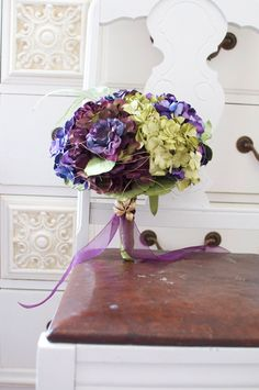 Vineyard harvest bouquet of deep plum, purple wine, vintage green and seasoned purple paper hydrangea accented with gold