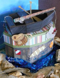 This boat box is from PICNIC IN THE PARK SVG KIT.  Sharalyn also used files from FOREST COUNTY SVG COLLECTION to embellish her project.  She did such a fabulous job!  And check out that fishing pole!  It's made using the pool stick from THE GREEN ROOM SVG KIT.  How creative is that!!!
