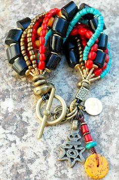 Super Exotic Black Coral, Red Coral, Turquoise, Amber Resin, Bronze and Ethiopian Silver Star Charm Bracelet $210
