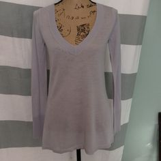 Pretty lightweight light gray sweater from WHBM This nice tunic length sweater has an expected layer on the back that gives it interest coming and going. 50% acrylic 50% wool. White House Black Market Sweaters V-Necks