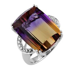 Ametrine Diamond Gold Ring    Awesome Ametrine ring enhanced by fourteen round, brilliant-cut Diamonds, weighing approx. 0.168 ct., rectangular dome facet-cut Ametrine measures approx. 19mm x 14mm, approx. weight 18.05ct.; mounted in 14k white gold with pierced gallery.