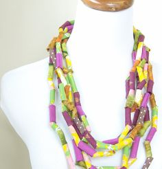 textile necklace with noodle looking beads