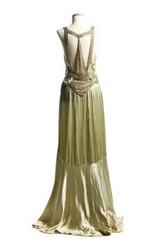 Light green satin evening dress, c. This stylish gown with a magnificent Art Deco design rhinestone ornamentation on the back was worn by the donor's sister, Eleanor Middleton Rutledge Hanson for her second court visit at Buckingham Palace in 1930s Fashion, Moda Fashion, Art Deco Fashion, Vintage Fashion, Victorian Fashion, Fashion Fashion, French Fashion, Ladies Fashion, Fashion Outfits