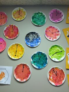 paper plate clocks teaches numbers time and color children loved painting the plates