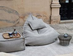 Do not let the simple form of the Sail Pouf fool you; once you sit in it, you may never want to get up. With this pouf, your body will be cocooned in a soft textured 100% wool fabric weave stuffed wit