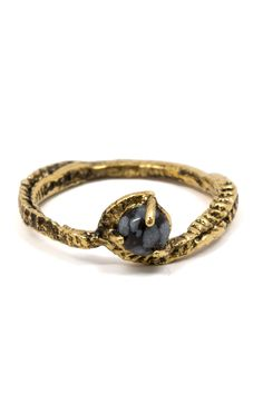 This ring was made just for all-powerful sea witches. Channel your inner Ursula and don this mysterious beauty. Details: 14k gold plated brass. Snowflake obsidian. Merewif derives its name from an Old