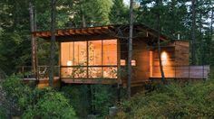 Texas firm Andersson-Wise has completed a rustic wooden cabin in the state of Montana that is raised on stilts to provide views of a nearby lake. Butterfly Roof, Contemporary Cabin, Flathead Lake, Barn Style Doors, Wooden Cabins, Wooden House, Flood Zone, Lake Cabins, Forest House