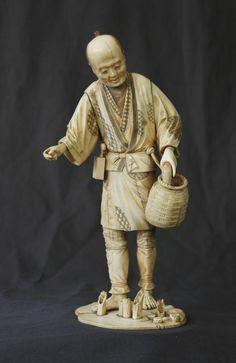 Ivory figure japanese girl holding fish