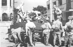 British Universal Carrier captured by Japanese soldiers in Hong Kong, Dec. 1941