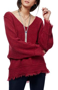 c1c48991a45e Free People Irresistible Fringe Trim Sweater in Wine. A slouchy
