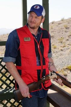 Blake Shelton. Hmmm. Never really though he was cute until he put a gun in his hands.