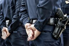 Police officers from behind - Images by Steve Skinner Photography/Getty Images