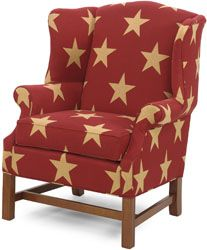 Don't know why, but I like this.  red, cream star patterned wingback chair