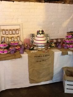 Personalised hessian sacks used as table decorations are a great idea for cake/sweetie tables at Ufton Court.