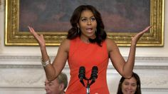 First lady Michelle Obama speaks during the Broadway at the White House event for high school students involved in performing arts programs in the State Dining Room of the White House in Washington, Monday, Nov. 16, 2015. Behind the first lady at left is composer Andrew Lloyd Webber and right is director Diane Paulus. (AP Photo/Carolyn Kaster)