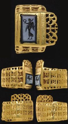 """A LATE ROMAN GOLD AND NICOLO KEY-RING  CIRCA LATE 3RD-EARLY 4TH CENTURY A.D., The inscription likely reading: MSVIPMARCIDA PENIHOMONOEA, """"Homonoea, wife of P(ublius) Marcus Dapienus, her husband,"""" the rectangular bezel set with a rectangular bevelled stone, engraved with a winged Victoria striding to the left, wearing a long chiton, holding a palm branch and wreath, the bezel projection with pierced-work peltae amidst tendrils"""