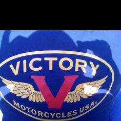 Victory Motorcycle logo on back of Clif's t-shirt.