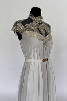 Art Nouveau inspired wedding dress, made of 3 layers of golden shimmering taupe chiffon, upper layer of pure silk, and golden French wedding lace along the neckline embellished with numerous little...