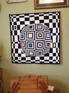 log cabin with a lens design- @ Sew and Tell Quilts- she is amazing