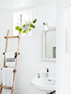 How to transform your bathroom into the ultimate home spa getaway. 8 home spa ideas to cleverly add luxury to your bathroom space with plants, bucolic elements and vibrantly patterned wall ideas. For more bathroom decor ideas go to Domino. Small Bathroom Storage, Laundry In Bathroom, Bathroom Ladder, Bathroom Styling, Simple Bathroom, Bathroom Ideas, Wood Bathroom, Washroom, Bathroom Organization