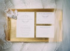 Classic silver and cream wedding stationery on gold tray | photography by http://claryphoto.com/