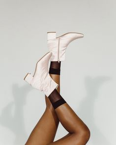 Set on a comfortable, low block heel, the Jacqui vegan ankle boot is a staple for all seasons. With its sculptural, modern design, this boot will dress up your outfit whilst still being wonderfully practical for everyday wear. With an inside zip, this boot is a breeze to slip into and head out the door. Combining comfort and style, it's no wonder the Jacqui boot is a best-seller, year after year. Block Heel Ankle Boots, Block Heels, Vegan Boots, Vegan Fashion, Pastel Pink, Shoe Brands, Crocs, Breeze, Modern Design