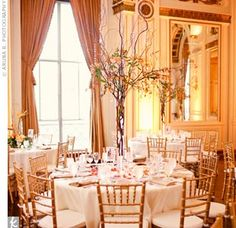Taller centerpieces of curly willow branches add height to the room. #wedding #bacheloretteandbride