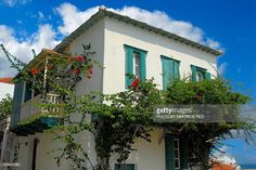 Traditional house at Hora Skopelos & in the depht the picturesque church Panagitsa(Small Virgin Mary) of chateau