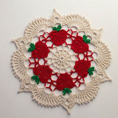 This is lovely work by Kate-Jenks on Ravelry. Project info Name Apple Doilies Pattern Apples for the Teacher Doily by Denise (Augostine) Owens Crochet Circles, Crochet Doily Patterns, Thread Crochet, Filet Crochet, Crochet Motif, Crochet Crafts, Crochet Stitches, Crochet Projects, Knitting Patterns
