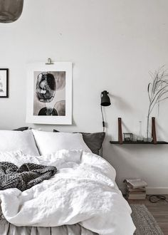 Happy Sunday, have you planned your holiday? Bedroom with wall art and plants. White bed sheets. Books on floor, black lamp #artliv  #interieurstyling #roominterior #interiør #homestyling #roomdecor #roomwithaview #windowview #homeinspiration #interiordesign #interiorblogger #lovemyhome  #homedecoration  #SundayFunday #WeekendVibes #SundayBrunch
