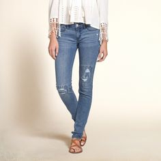 Girls Hollister Super Skinny Jeans | Rich color with fading and whiskering through thighs, hand-done destruction and patchwork detail, right coin pocket and signature back pocket stitching | HollisterCo.com