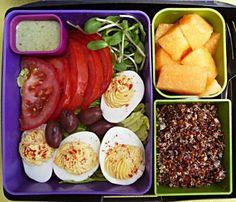 Nutritional Lunch - deviled eggs on a bed of lettuce, tomato slices, Kalamata olives, sunflower seed sprouts, cilantro dressing, red quinoa, cantaloupe chunks