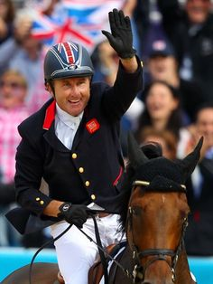 Peter Charles of Great Britain celebrates winning the jump-off against the Netherlands to win the gold medal in Team Jumping on Day 10 of the London 2012 Olympic Games at Greenwich Park.