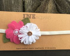 Hand sewn elastic headband with two felt flowers and wooden