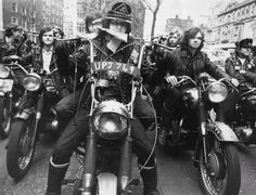 Eighteen-year-old Paul Wilkins from Kentish Town, London, president of the 'Devil's Henchmen' motorcycle gang whose members belong to the Islington YMCA, leads the group on a run delivering mail for the YMCA, during a London postal strike.