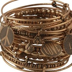 Coming Soon to Coastal Jewelers...  Alex & Ani!  Here's just one great example of the great pieces they offer!  This set of 21 Signature Expandable bangles is sure to make a sexy statement on your wrist. Featuring 10 plain bangles, 3 bangles adorned with charms, and 8 bangles embellished with metal smooth oval, ribbed, dotted ball and cylindrical beads.