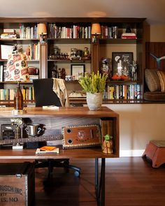 Raw storage space in a Hollywood writer's home is transformed into a masculine home office hybrid