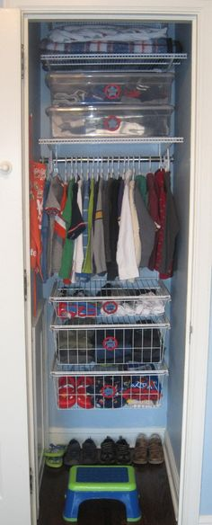 A small kids closet organized to maximize space and get critical items at kids height. Includes a DIY label system that plays on Superhero that boys will love.